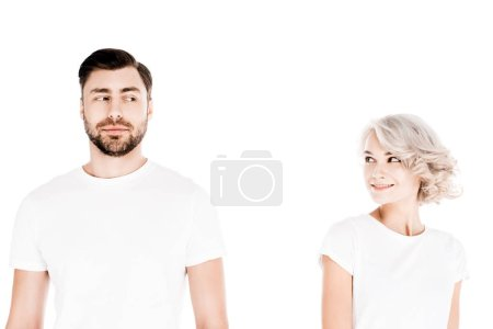 Wonderful couple in white t-shirts looking at each other isolated on white
