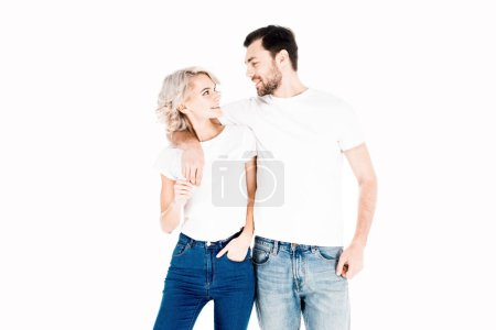 Photo for Happy smiling couple hugging while looking at each other isolated on white - Royalty Free Image