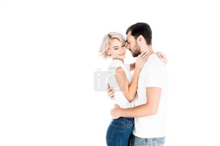 Photo for Happy young adult couple hugging isolated on white - Royalty Free Image