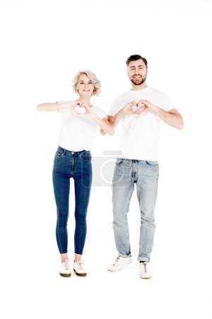 Photo for Smiling beautiful  young adult  couple showing heart shape gesture with fingers love isolated on white - Royalty Free Image