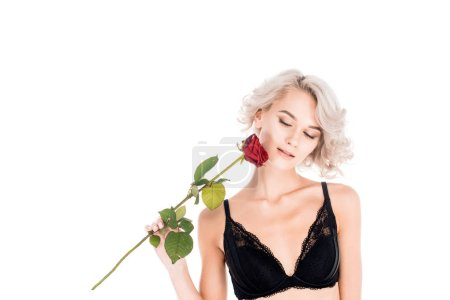 Wonderful blonde woman holding beautiful red rose isolated on white