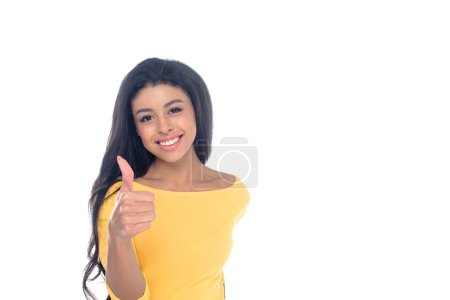 attractive african american girl showing thumb up and smiling at camera isolated on white