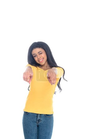 happy young african american woman pointing at camera isolated on white