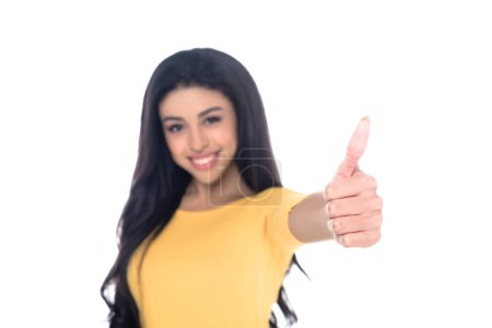 close-up view of young african american woman showing thumb up and smiling at camera isolated on white