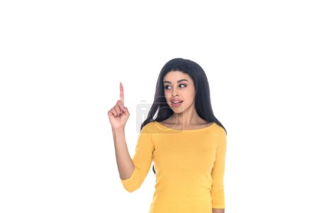 young african american woman pointing up with finger and looking away isolated on white