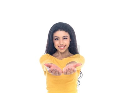 young african american woman reaching hands and smiling at camera isolated on white