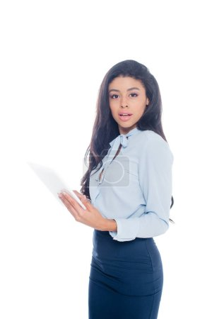 beautiful young african american businesswoman holding digital tablet and looking at camera isolated on white