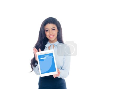 Photo for Beautiful young african american woman holding digital tablet with twitter application on screen and smiling at camera isolated on white - Royalty Free Image