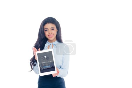 Photo for Beautiful young african american woman holding digital tablet with tumblr application on screen and smiling at camera isolated on white - Royalty Free Image