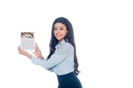 Photo for Beautiful young african american woman holding digital tablet with foursquare website on screen and smiling at camera isolated on white - Royalty Free Image