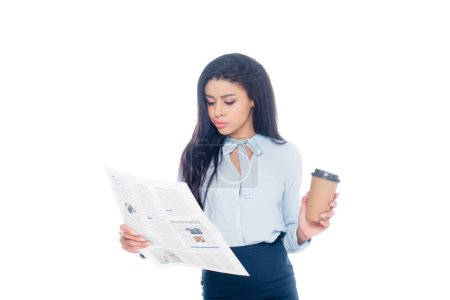 serious young african american businesswoman holding paper cup and reading newspaper isolated on white