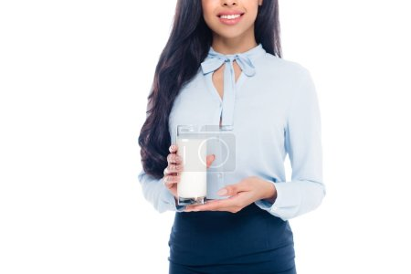 cropped shot of happy young african american woman holding glass of milk isolated on white