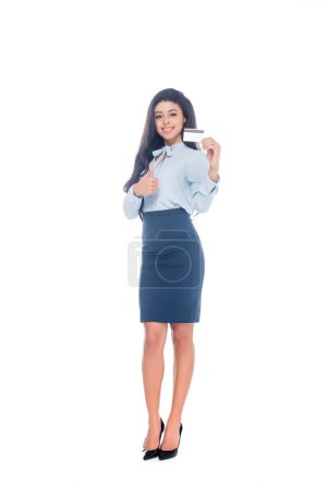 happy young african american businesswoman holding credit card and showing thumb up isolated on white