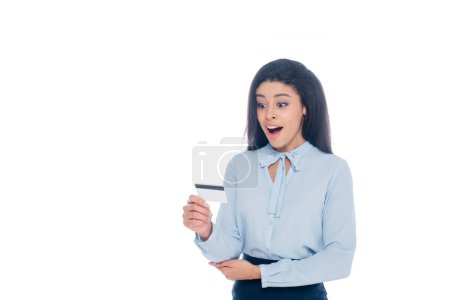 surprised young african american woman holding credit card isolated on white