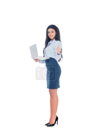 young african american businesswoman holding laptop and showing thumb up isolated on white
