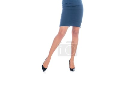 low section of businesswoman in skirt and formal shoes on heels isolated on white