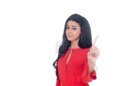 african american girl in red dress gesturing by finger isolated on white