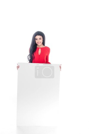 cheerful african american girl in red dress showing empty banner isolated on white