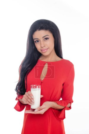 attractive african american girl holding glass of milk isolated on white