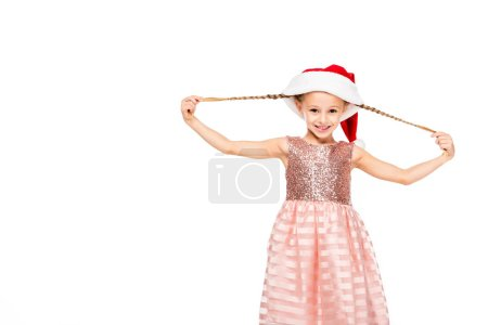 adorable little child in santa hat stretching her tails and looking at camera isolated on white