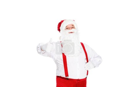 santa claus in suspenders showing thumb up isolated on white