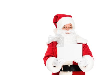 Photo for Santa claus holding laptop and looking at camera isolated on white - Royalty Free Image