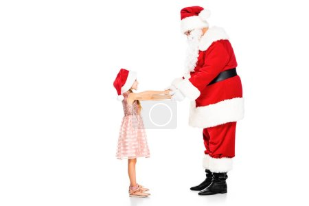 side view of santa claus and little child holding hands isolated on white