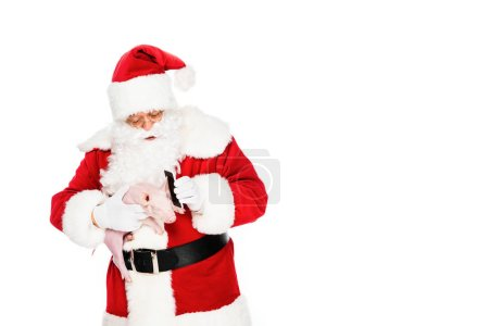 santa claus holding piggy in hand and giving her phone for talk isolated on white