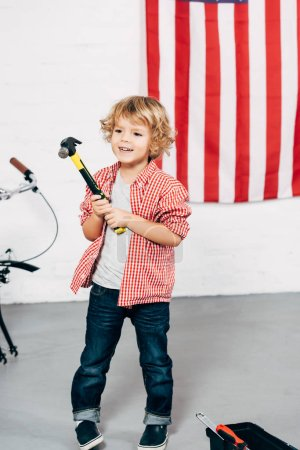 Photo for Selective focus of happy adorable boy holding hammer - Royalty Free Image