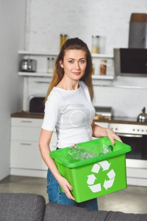 beautiful woman standing with recycle green box at kitchen