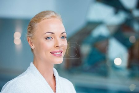 Close up of beautiful woman standing in white bathrobe
