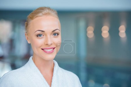 Close up of beautiful woman smiling in white bathrobe