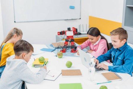 attentive children working at STEM robotics lesson
