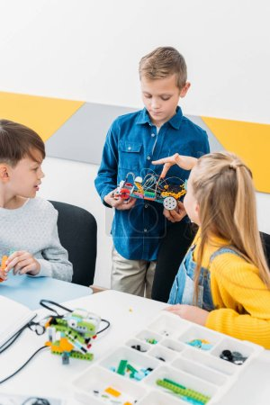 children making electric robot in stem education class