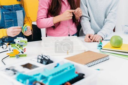 Photo for Cropped view of children at desk in stem education class - Royalty Free Image