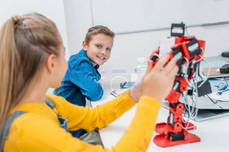 Photo for Schoolchildren programming robot together during STEM educational class - Royalty Free Image