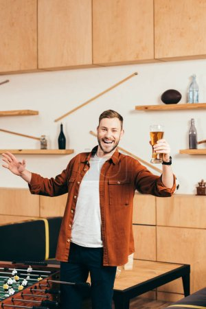 Photo for Happy man with glass of beer in cafe - Royalty Free Image