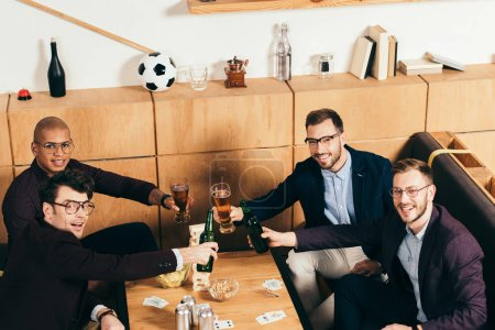 high angle view of multiracial business team clinking drinks while resting together in cafe