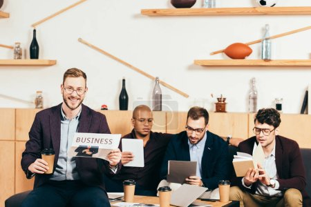 Photo for Portrait of young multicultural businessmen in cafe - Royalty Free Image