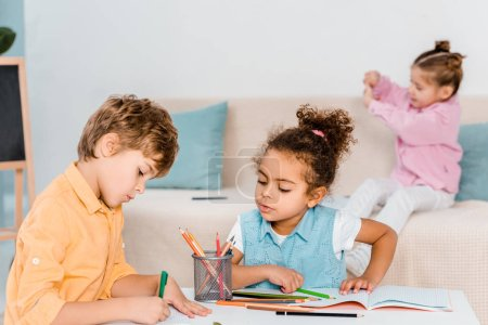 adorable multiethnic children drawing with pencils