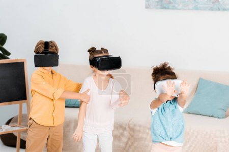 adorable little kids using virtual reality headsets together