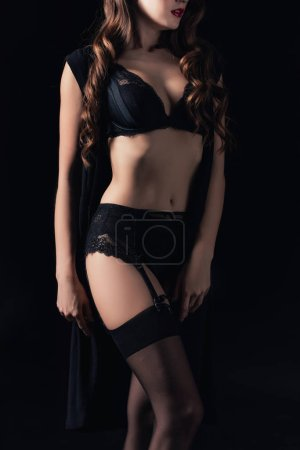 Photo for Cropped view of woman posing in seductive lingerie isolated on black - Royalty Free Image