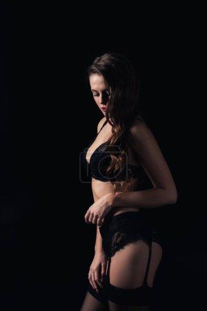 Photo pour Belle femme qui pose en lingerie isolée sur fond noir - image libre de droit