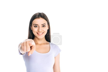 portrait of smiling attractive woman pointing at camera isolated on white