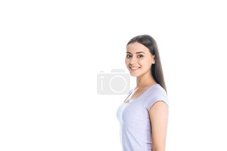 Foto de Vista lateral del atractivo alegre joven aislada en blanco - Imagen libre de derechos