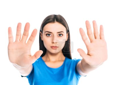 Photo for Portrait of serious woman with outstretched hands isolated on white - Royalty Free Image