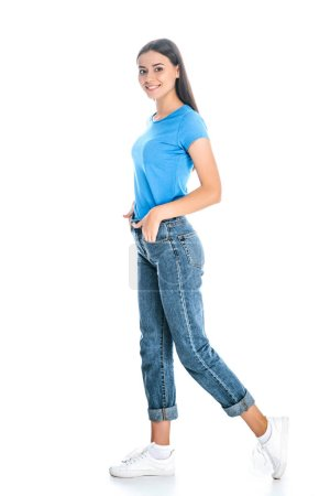 side view of stylish woman in jeans isolated on white
