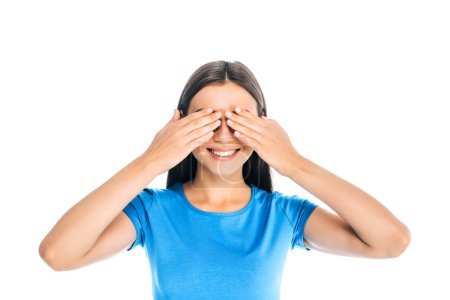 obscured view of cheerful woman covering eyes with hands isolated on white