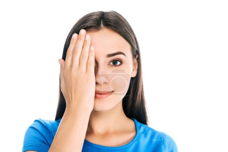 Photo for Obscured view of smiling woman covering eye with hand isolated on white - Royalty Free Image