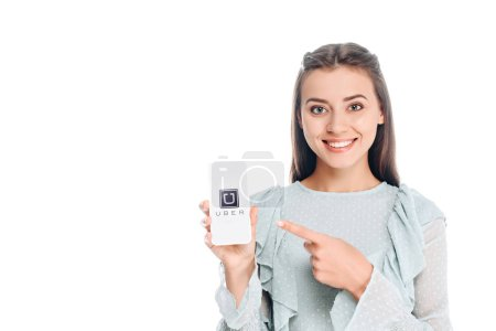 smiling woman showing smartphone with uber logo isolated on white